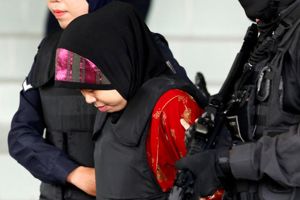 Indonesian Siti Aisyah is escorted as she leaves the Shah Alam High Court on the outskirts of Kuala Lumpur