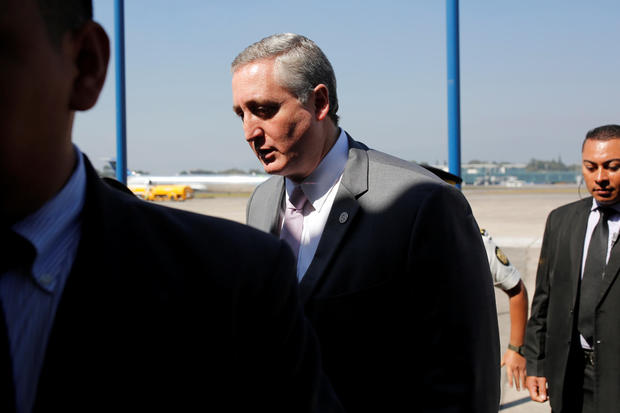 Guatemalan Interior Minister Enrique Degenhart is seen after the arrival of a flight of migrants deported from U.S., at La Aurora International airport in Guatemala